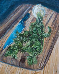 a celeriac sitting on a cutting board with a kitchen knife