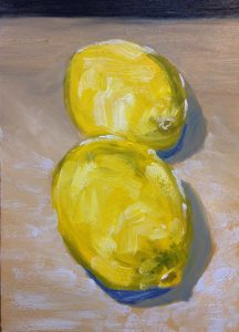 Two lemons on brown paper